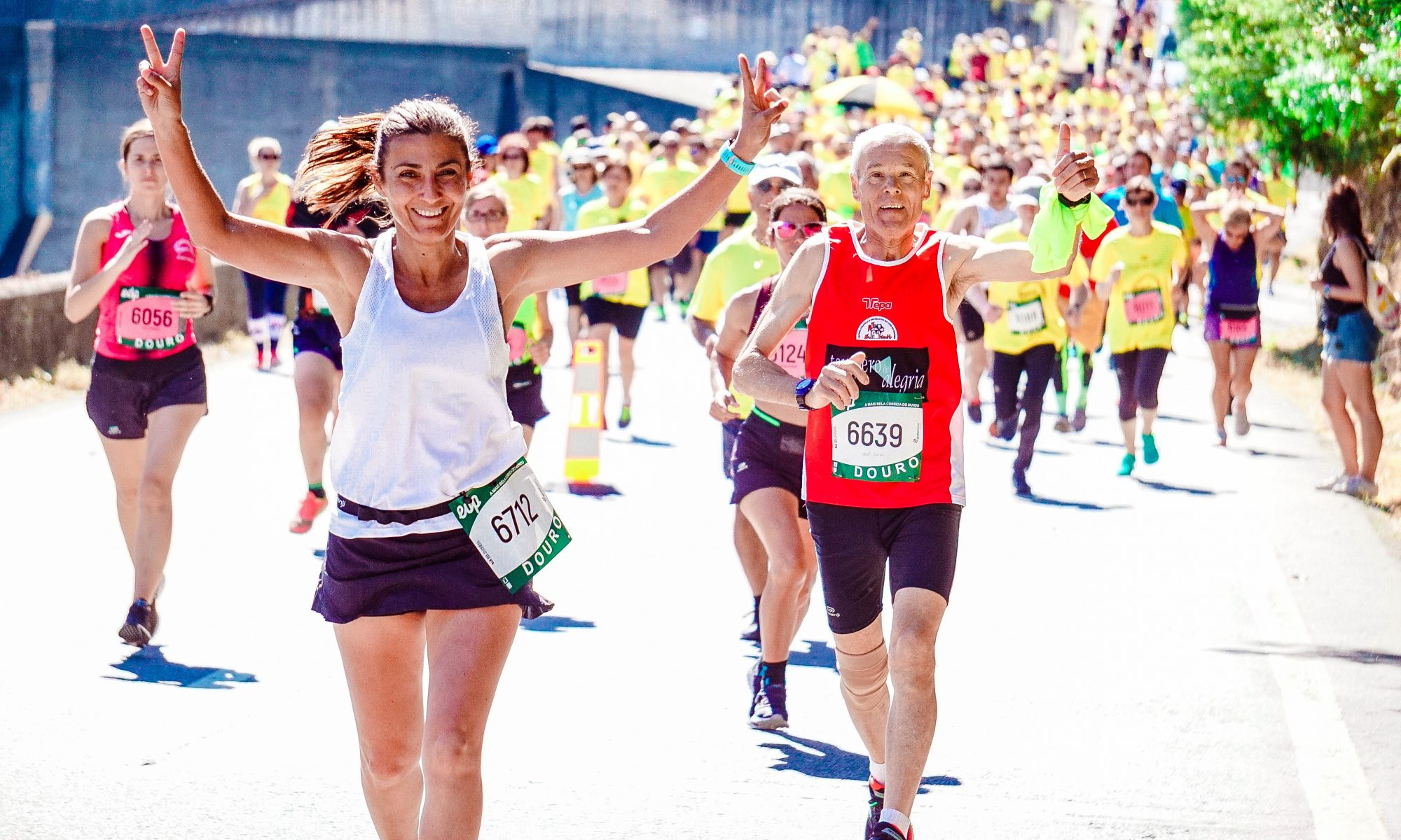 Canva - Female and Male Runners on a Marathon